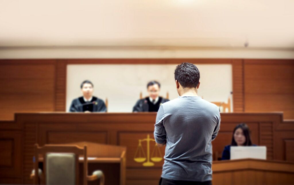 man standing before judges